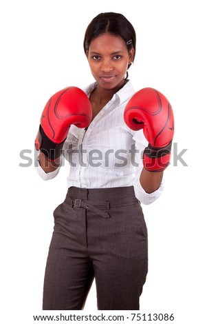 Young African American woman wearing boxing gloves - stock photo