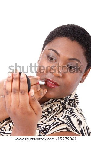 Young African American Woman with Red Lipstick Looking at Mirror