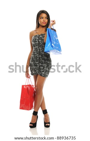 Young African American Woman with shopping bags isolated on a white background - stock photo