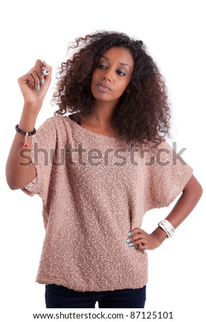 Young African american woman  writing something on glass board with marker - stock photo