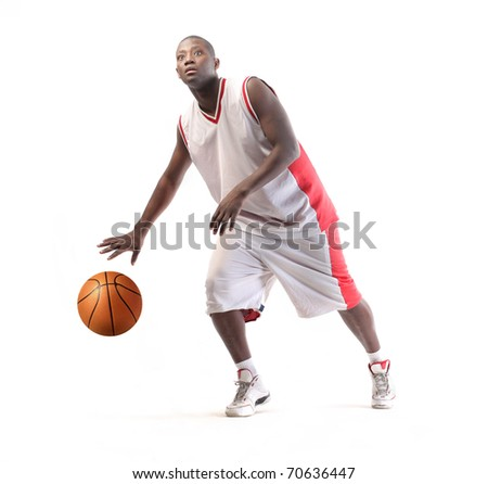 Young african basketball player in action - stock photo