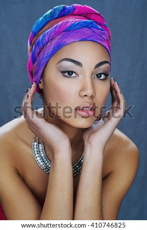 Young African beauty in ethnic headpiece - stock photo