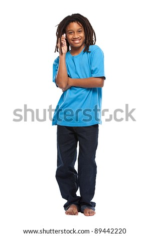 young african boy posing with cellphone in studio - stock photo
