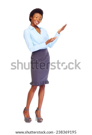 Young african business woman presenting copyspace isolated white - stock photo