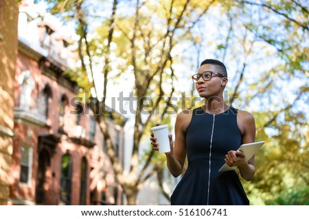 Young african business woman walking down the street