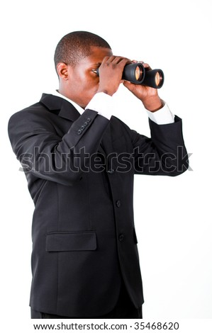 Young African businessman looking with binoculars downwards