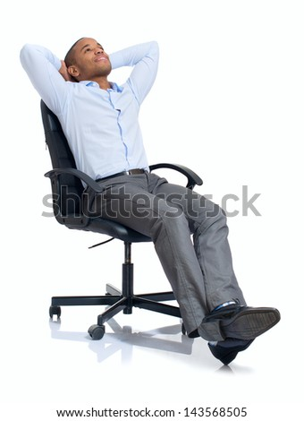 Young African Businessman Relaxing On Chair Over White Background - stock photo