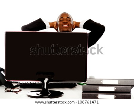 Young african businessman relaxing with hands behind head - stock photo