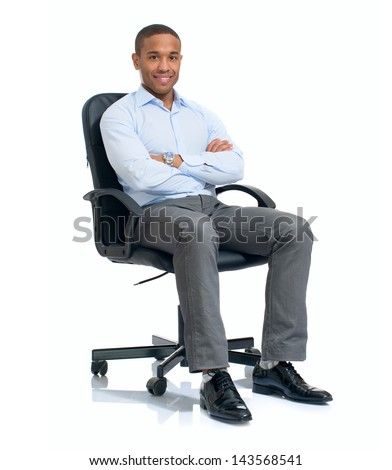 Young African Businessman Sitting On Chair Over White Background