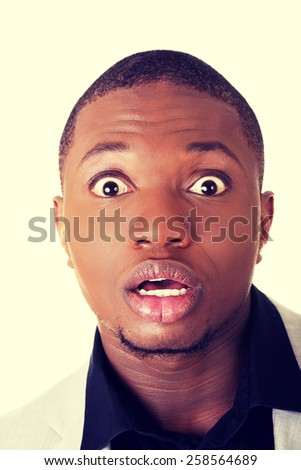 Young african businessman with a shocked facial expression.