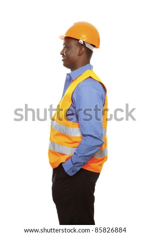 Young African constructor standing in profile isolated on white. - stock photo