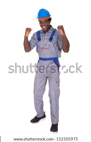Young African Craftsman Clenching His Fist Isolated Over White Background - stock photo