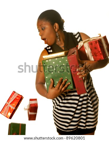 Young african girl dropping a few christmas presents - stock photo