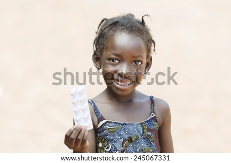 Young African Girl Showing Medicine Pills To Cure Diseases - stock photo