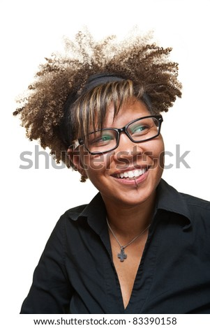 Young African girl smiles towards something off camera in front of a white background. - stock photo