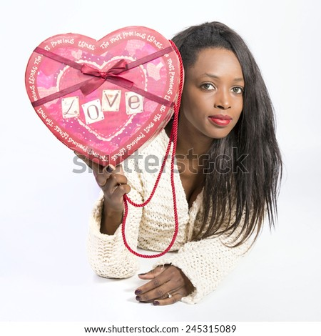 Young African girl with a heart of san valentin day - stock photo