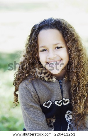 Young African girl with braces smiling - stock photo