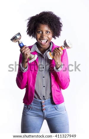 Young African girl with cup of victory - stock photo