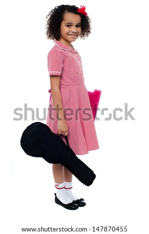 Young african kid heading for the music class - stock photo