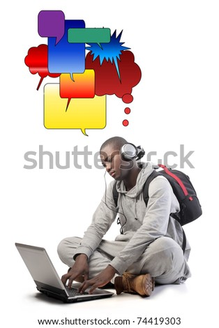 Young african man communicating with a laptop - stock photo