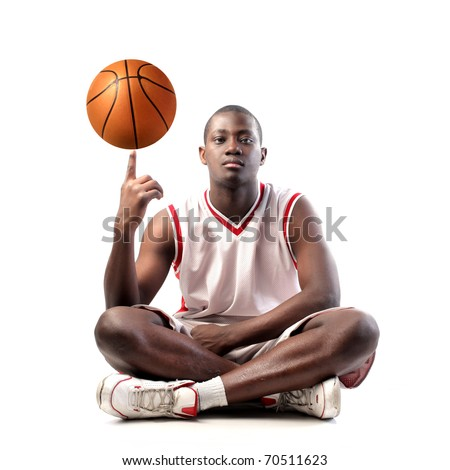Young african man holding a basketball on his finger - stock photo