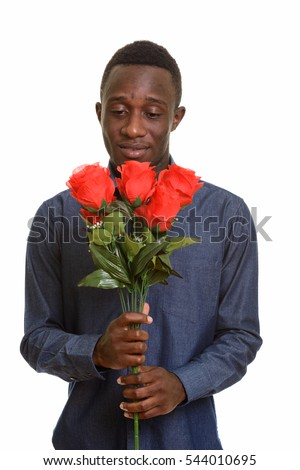 Young African man holding red roses ready for Valentine's day isolated against white background