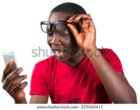 Young african man looking at smartphone - stock photo