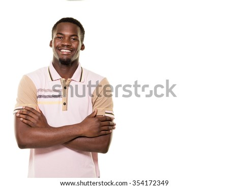 Young African man posing on white background.