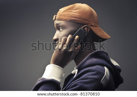 Young african man talking on the mobile phone - stock photo