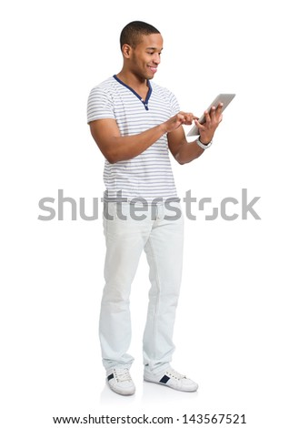 Young African Man Using Digital Tablet Over White Background - stock photo