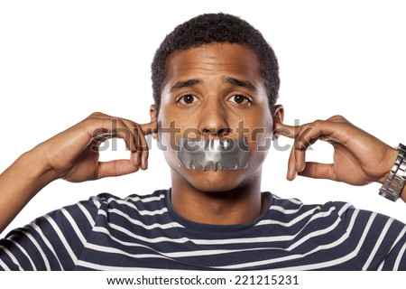 Young African man with closed ears and adhesive tape over his mouth - stock photo