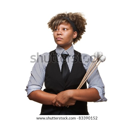 Young African musician in a serious pose against a white background in the studio. - stock photo