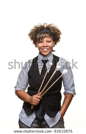 Young African musician poses with her mallets against a white background in the studio. - stock photo