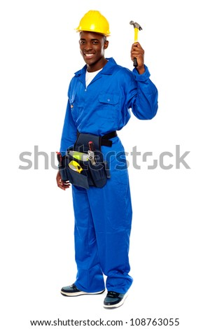 Young african repairman holding hammer isolated against white background