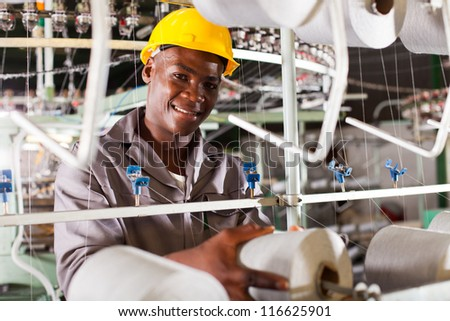 young african textile industry worker in factory - stock photo