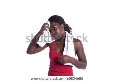Young african woman cleaning her seat after the exercise (isolated on white) - stock photo