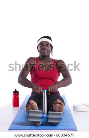 young african woman doing some personal exercise (isolated on white) - stock photo
