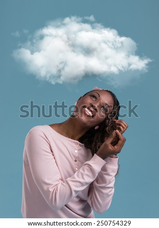 Young african woman dreaming while looking up for thought bubble above her head with copy space - stock photo