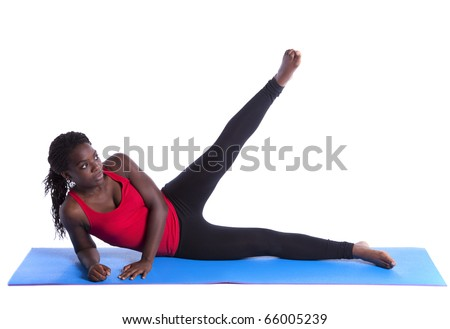 young african woman exercising with perfect body balance (isolated on white) - stock photo
