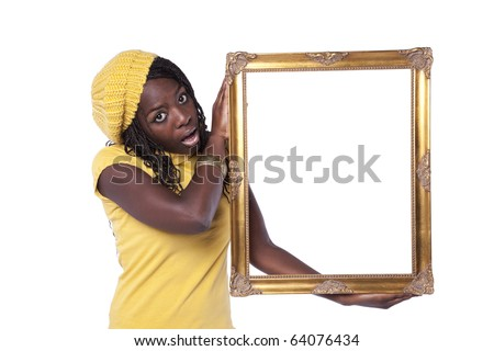 young african woman holding a picture frame with a funny expression (isolated on white) - stock photo