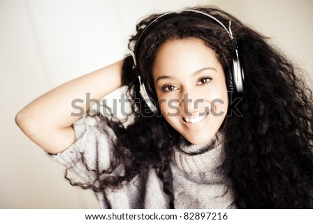 Young african woman in her bedroom - stock photo