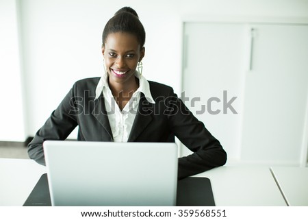Young african woman in the office - stock photo