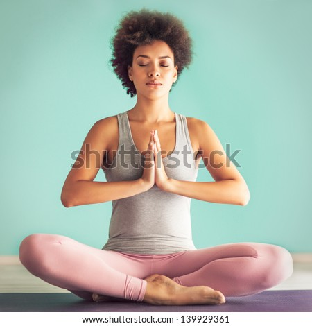 Young African woman in the prayer position. - stock photo