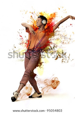 Young african woman listening to music and dancing - stock photo