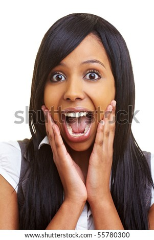 Young african woman looking surprised into the camera - stock photo