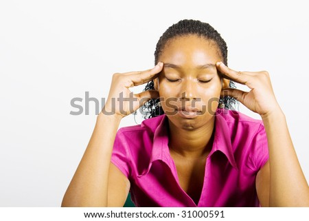 young african woman looks worried - stock photo