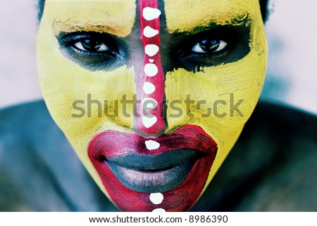 Young African woman painted traditional, lomography  look - stock photo