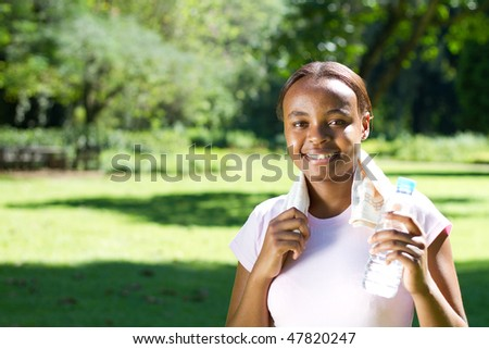 young african woman relaxing after workout - stock photo