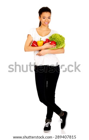 Young african woman with healthy vegetables.