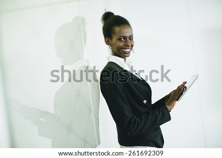 Young african woman with tablet in the office